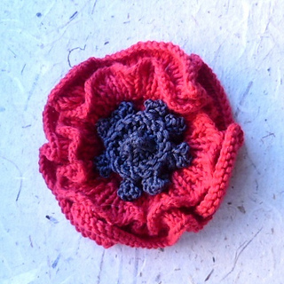 Knitting Pattern For Poppy Flowers : Ravelry: Remembrance Poppy to knit pattern by Katy Sparrow